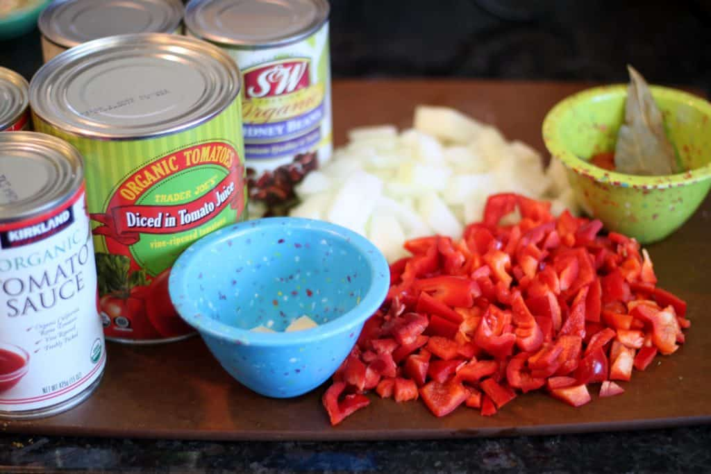 ingredients for kielbasa chili prepped on a cutting board