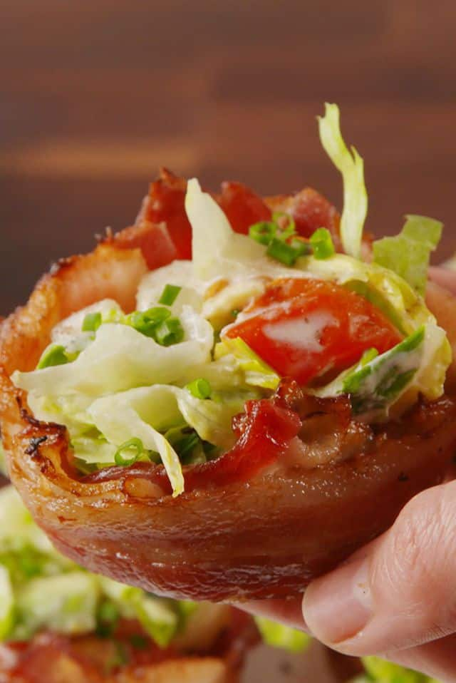 low carb blt cups in a persons hand