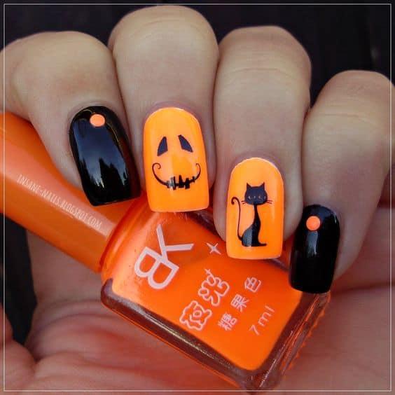 Fun black and orange pumpkin nails