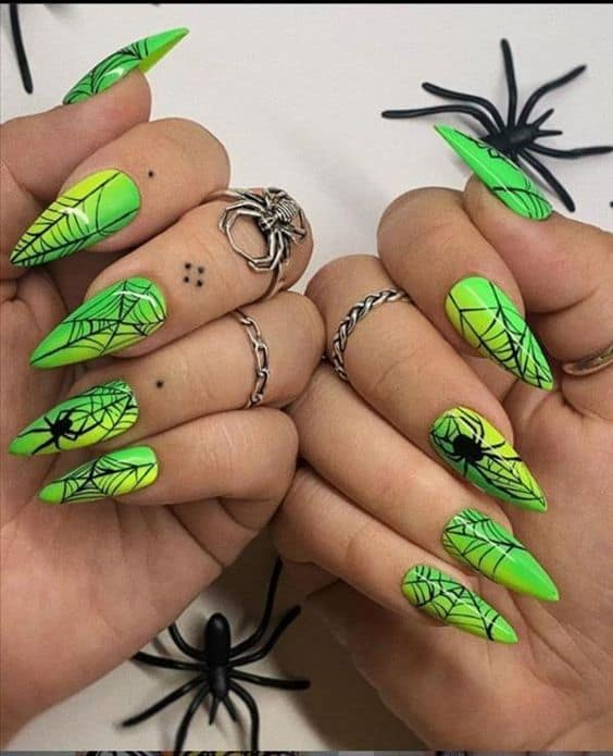 Green spooky spiderweb nails