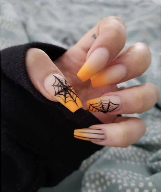 Cute orange tip spider web nails