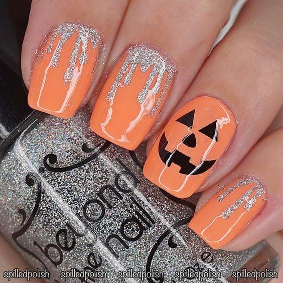Cute silver sparkle pumpkin nails