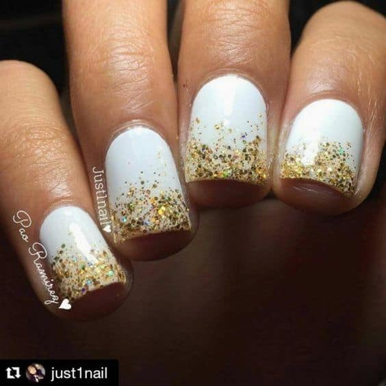 cutest holiday nails gold glitter and white