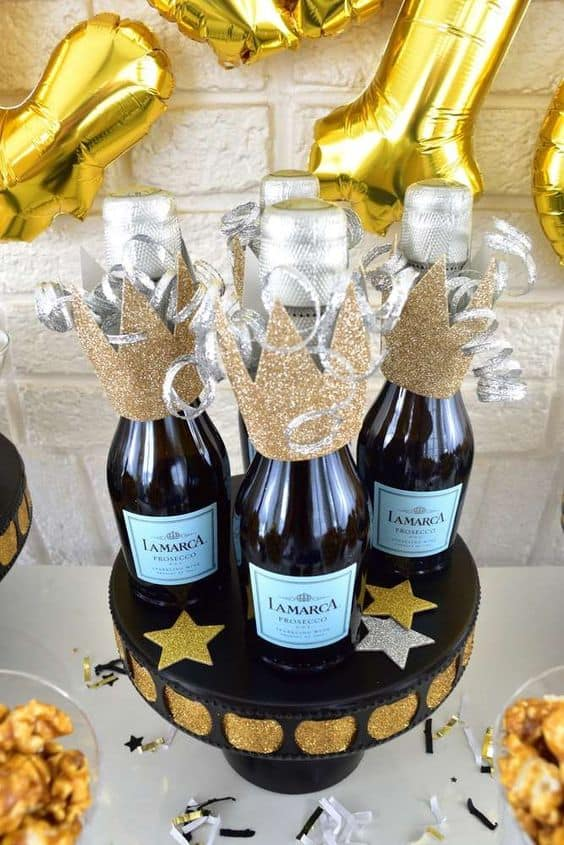 fun inspo for nye party champagne bottle crowns