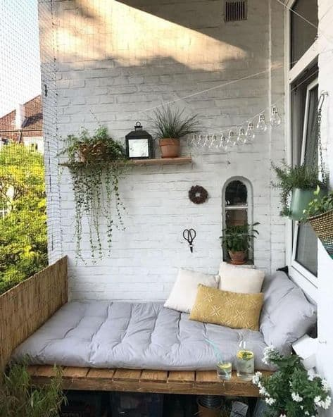 balcony decorating ideas that are cute cushion bed with pillows