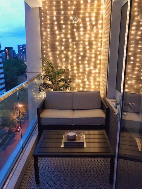 cutest decor ideas for balcony wall of lights and cute mini sofa
