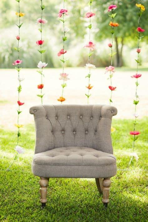 grad backdrop ideas chair with flower curtain