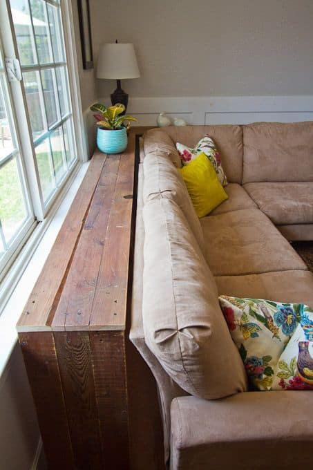 small spaces organization tips behind the couch wooden table